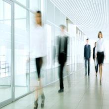 People walking in an office space