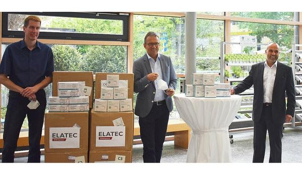 Stefan Haertel, Chief Executive Officer of RFID specialist Elatec, donates face masks for Disaster Control Department